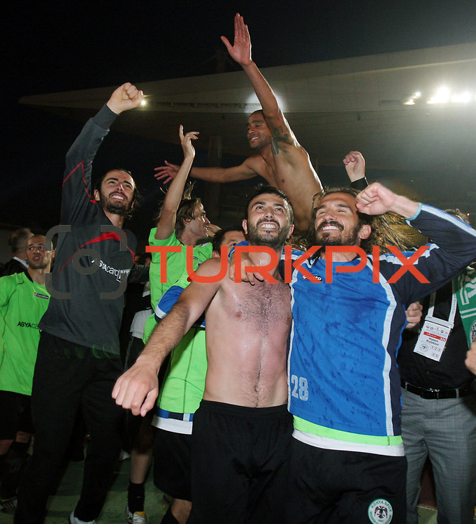 Konyaspor's players Yusuf KURTULUS (R) celebrates victory during their Turkish soccer Play Off final match Altayspor between Konyaspor at Ataturk Olympic Stadium in Istanbul Turkey on Sunday, 23 May 2010. Photo by TURKPIX