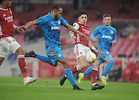 Football - 2020 / 201 UEFA Europa League - Round 16 - Second Leg - Arsenal vs Olympiakos - Emirates Stadium<br /> <br /> Youssef El - Arabi of Olympiacos and Hector Bellerin of Arsenal<br /> <br /> <br /> Credit : COLORSPORT/ANDREW COWIE