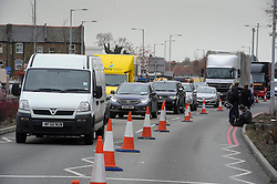 © Licensed to London News Pictures. 03/12/2013 London, UK. Traffic builds up on the North Circular Road where a  teenager has been stabbed to death. Officers were called to the address  in Palmers Green where they found the 17-year-old from Haringey. Photo credit : Simon Jacobs/LNP