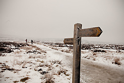 © Licensed to London News Pictures. 10/02/2012. Derbyshire, UK. Two brave hill walkers set out across the frozen Pennine Way, in the Peak District, in sub-zero termparates. Photo credit : Joel Goodman/LNP