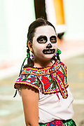 A young girl in costumes celebrating the Day of the Dead festival known in Spanish as Día de Muertos at the town square October 31, 2013 in Oaxaca, Mexico.
