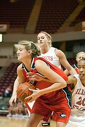 26 November 2005: Tiffany Hudson is caught reaching in on Jennifer Uptmor. The Illinois State Redbirds were triumphant over the Northern Illinois Huskies 60 - 50 at the final buzzer.  The game was played at Redbird Arena on the campus of Illinois State University in Normal IL
