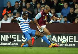 Queens Park Rangers's Nedum Onuoha tackles Aston Villa's Gabriel Agbonlahor - Photo mandatory by-line: Robbie Stephenson/JMP - Mobile: 07966 386802 - 07/04/2015 - SPORT - Football - Birmingham - Villa Park - Aston Villa v Queens Park Rangers - Barclays Premier League