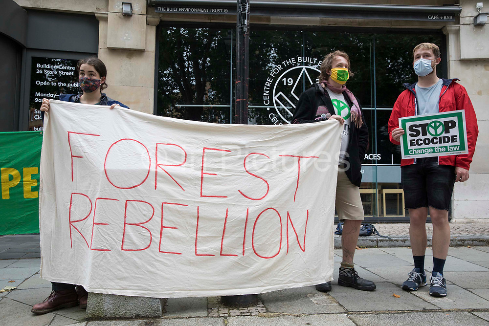 Activists from the Forest Rebellion, known as Skogsupproret in Sweden, protest outside the premises of the Timber Trade Federation at the Building Centre on 24th July 2021 in London, United Kingdom. The activists were protesting against the clearcutting of natural forests in Sweden and the social and environmental impacts of timber imports from Swedish logging companies with UK subsidiaries belonging to the Timber Trade Federation, whilst also standing in solidarity with the indigenous Sami people of northern Scandinavia and demanding that their rights be respected. Sweden is the largest lumber supplier to the UK.