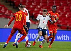 LONDON, ENGLAND - Thursday, October 8, 2020: England's captain Kieran Tripper (L) and Wales' Rabbi Matondo during the International Friendly match between England and Wales at Wembley Stadium. The game was played behind closed doors due to the UK Government's social distancing laws prohibiting supporters from attending events inside stadiums as a result of the Coronavirus Pandemic. England won 3-0. (Pic by David Rawcliffe/Propaganda)