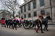 London Wednesday 17th April 2013. The funeral of former Prime Minister Baroness Margaret Thatcher. The horse drawn gun carriage carrying the coffin of Margaret Thatcher leaves St Clement Danes Church on it's procession down Fleet Street.