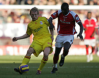 Photo: Lee Earle.<br /> Charlton Athletic v Liverpool. The Barclays Premiership. 16/12/2006. Liverpool's Dirk Kuyt (L) battles with Amady Faye.
