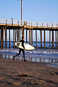 Getting ready to go surfing at Pismo Beach.