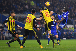 Cardiff City's Sol Bamba (right) and Watford's Craig Cathcart (centre right) battle for the ball during the Premier League match at the Cardiff City Stadium.