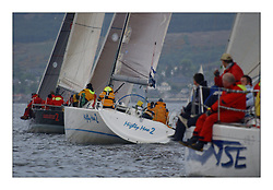 Yachting- The first days racing  of the Bell Lawrie Scottish series 2003 at Gourock.  The wet start looks set to last for the overnight race to Tarbert... No Sense, Mighty Moe 2 and Absolutely 2 GBR4334L of class two head to Cloch....Pics Marc Turner / PFM