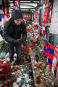 Moscow, Russia, 15/01/2011..A man lights candles during a rally at the bus stop where Spartak soccer fan Yegor Sviridov was killed in a street fight with a group of men from the southern Caucasus, leading to a nationalist backlash that has spilled into racist violence on the streets of Moscow and other Russian cities. The rally on the 40th day after Sviridov's death was attended by a mixture of local people, football fans and Russian nationalists.