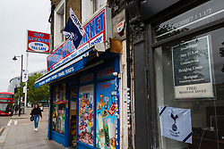 A Tottenham Hotspurs flag flies outside a shop near the Club's stadium ahead of Tottenham's Champions League final with Liverpool to be played at Atletico Madrid's Wanda Metropolitano Stadium in Madrid. Tottenham, London, May 29 2019.