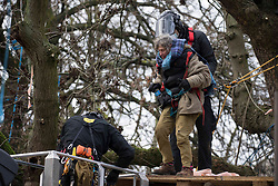 © Licensed to London News Pictures.31/01/2021, London,UK. Bailiffs remove a protestor as the eviction of HS2 Rebellion group from Euston Square Gardens in central London continues. Eco-activists are living in increasingly unstable tunnels beneath the square. Photo credit: Marcin Nowak/LNP