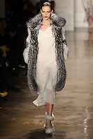 Aymeline Valade walks the runway wearing Altuzarra Fall 2011 Collection during Mercedes-Benz Fashion Week in New York on February 12, 2011