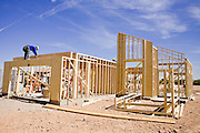 14 MAY 2007 -- AVONDALE, AZ: Housing construction in Avondale, Arizona, a suburb about 15 miles from Phoenix. The Phoenix housing market, like much of the rest of the US is still flat. Housing sales in April, 2007 were the fewest since April, 2000 and down nearly 50 percent since April, 2005. The Phoenix area, which enjoyed a record setting boom from 2002 through 2005, has one of the most volatile housing markets in the country and starts are down by more than 20 percent. Some home builders are laying workers off as the decline continues. Photo by Jack Kurtz/ZUMA Press