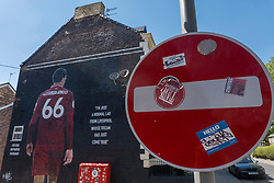 """LIVERPOOL, ENGLAND - Monday, June 1, 2020: Stickers on a """"No Entry"""" sign in front of a mural of Liverpool FC player Trent Alexander-Arnold near Anfield. The mural was commissioned by The Anfield Wrap. (Pic by David Rawcliffe/Propaganda)"""