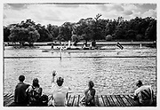 """Henley. Berks, United Kingdom. 17th June 2017, Spectators, watch and wave, sitting  on the slipway of, """"Upper Thames RC.,""""  watch as the Umpires Launch, """"Consulta"""", passes  2017 Henley' Women's Regatta. Rowing on, Henley Reach. River Thames. <br /> <br /> <br /> Saturday  17/06/2017<br /> <br /> <br /> """"Film Noir Style Photography"""", © Peter SPURRIER,"""