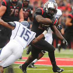 Oct 6, 2012: Rutgers Scarlet Knights running back Jawan Jamison (23) rushes through Connecticut Huskies safety Ty-Meer Brown's (15) arm-tackle during second half NCAA college football action between the Rutgers Scarlet Knights and UConn Huskies at High Point Solutions Stadium in Piscataway, N.J.