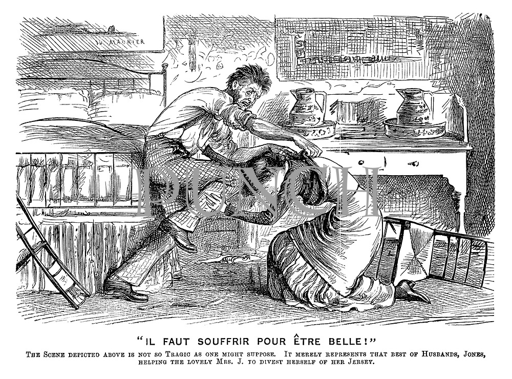 """""""Il Faut Souffrir Pour Etre Belle!"""" The scene depicted above is not so tragic as one might suppose. It merely represents that best of husbands, Jones, helping the lovely Mrs J to divest herself of her jersey."""