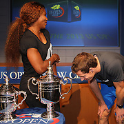 Defending US Open Champions Andy Murray takes a moment to check if his name in on the trophy after a photo shoot with Serena Williams at the 2013 US Open draw ceremony. Flushing. New York, USA. 22nd August 2013. Photo Tim Clayton