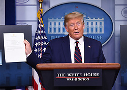 President Donald Trump holds a memo stating he tested negative during a Coronavirus briefing at the White House on Thursday, April 2, 2020 in Washington, DC. Due to the COVID-19 pandemic, at least 5,700 people have died in the United States with more than 200,000 infected. More than 10 million people have lost their jobs in the U.S. in the past two weeks. Photo Kevin Dietsch/Pool/ABACAPRESS.COM