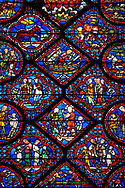 Medieval stained glass Window of the Gothic Cathedral of Chartres, France - dedicated to Noah and The Flood. Bottom Diamond panel - God instructs Noah to build an ark - The two panels below and the panels left and right show God instructing Noah to build an ark . Panel top left - Noah's sons; Shem, Ham and Japheth, panel top right - Noah's wife and daughters in law . Top central diamond - Noah and one of his sons constructing the Ark, top left  and right - Animals approaching the ark two by two. A UNESCO World Heritage Site. .<br /> <br /> Visit our MEDIEVAL ART PHOTO COLLECTIONS for more   photos  to download or buy as prints https://funkystock.photoshelter.com/gallery-collection/Medieval-Middle-Ages-Art-Artefacts-Antiquities-Pictures-Images-of/C0000YpKXiAHnG2k