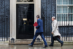 © Licensed to London News Pictures. 12/03/2018. London, UK. Defence Secretary Gavin Williamson (L) enter 10 Downing Street ahead of a National Security Council meeting where the Salisbury spy incident is to be discussed. Photo credit: Rob Pinney/LNP