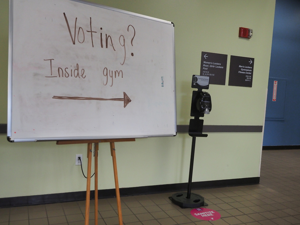 Voters entering this polling location were directed to the gym, reminded to maintain social distancing with circles on the floor spaced six feet apart and provided with hand sanitizer to cleanse their hands prior to voting.