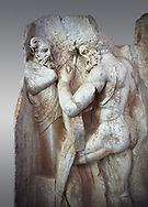 Close up of a Roman Sebasteion relief sculpture of  Herakles is preparing to wrestle the Libyan giant Antaios. Aphrodisias Museum, Aphrodisias, Turkey.<br /> <br /> Herakles (left) is taking off his bow case to hang it on a pillar statue. Antaios (right) is binding up his head with ear protectors, next to him stands an oil basin used in the palaistra (wrestling ground). Antaios was a famous wrestler who challenged and killed all visitors to his country, until he was defeated by Herakles. .<br /> <br /> If you prefer to buy from our ALAMY STOCK LIBRARY page at https://www.alamy.com/portfolio/paul-williams-funkystock/greco-roman-sculptures.html . Type -    Aphrodisias     - into LOWER SEARCH WITHIN GALLERY box - Refine search by adding a subject, place, background colour, museum etc.<br /> <br /> Visit our ROMAN WORLD PHOTO COLLECTIONS for more photos to download or buy as wall art prints https://funkystock.photoshelter.com/gallery-collection/The-Romans-Art-Artefacts-Antiquities-Historic-Sites-Pictures-Images/C0000r2uLJJo9_s0