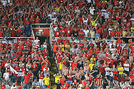 The Wales away fans show their support, thousands travelled to Cyprus and if Wales qualify for France then large numbers are expected to travel as Wales look to qualify for a major tournament for the 1st time since 1958. UEFA EURO 2016 Qualifier between Cyprus and Wales at GPS Stadium in Nicosia, Cyprus on Thursday 3rd Sept 2015. pic by Gareth John, Andrew Orchard sports photography.