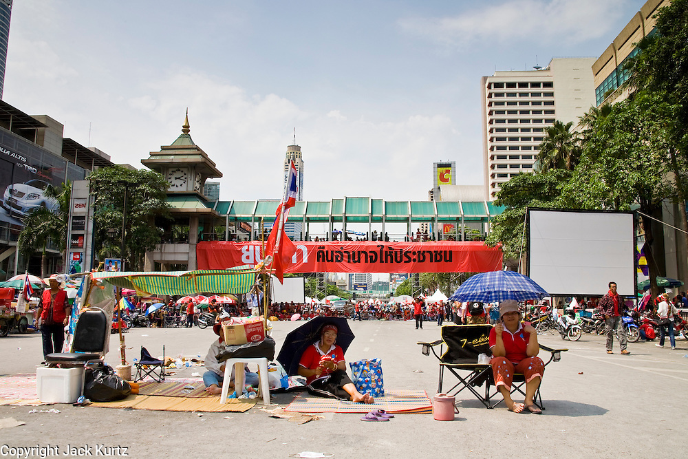 16 APRIL 2010 - BANGKOK, THAILAND:  Red Shirt protestors have the street to themselves during the heat of the day. The Red Shirts continue their protest at Ratchaprasong Intersection in the heart of Bangkok's upscale shopping and hotels. They are calling on Prime Minister to step down and dissolve the parliament. Most of the Red Shirts support former Prime Minister Thaksin Shinawatra, who was deposed by a military coup in 2006 and is now living outside of Thailand. The Red Shirts want Thaksin to return to Thailand.   PHOTO BY JACK KURTZ
