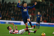 Zlatan Ibrahimovic of Manchester Utd is tackled by Glenn Whelan of Stoke city .  Premier league match, Stoke City v Manchester Utd at the Bet365 Stadium in Stoke on Trent, Staffs on Saturday 21st January 2017.<br /> pic by Andrew Orchard, Andrew Orchard sports photography.
