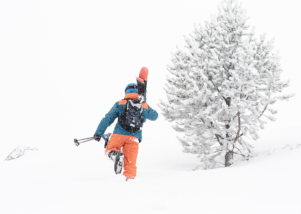 Skier going up the mountain during backcountry skiing