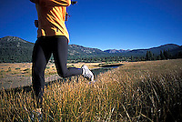 Heather Harrison running along the West Fork of the Carson River in in Hope Valley, CA.