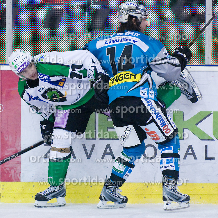 Bostjan Golicic (HDD Tilia Olimpija, #71) vs Justin Keller (EHC Liwest Black Wings Linz, #14) during ice-hockey match between HDD Tilia Olimpija and EHC Liwest Black Wings Linz in 37th Round of EBEL league, on Januar 9, 2011 at Hala Tivoli, Ljubljana, Slovenia. (Photo By Matic Klansek Velej / Sportida.com)