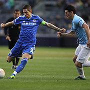 Fermando Torres, Chelsea, shoots past Gareth Barry, Manchester City, during the Manchester City V Chelsea friendly exhibition match at Yankee Stadium, The Bronx, New York. Manchester City won the match 5-3. New York. USA. 25th May 2012. Photo Tim Clayton