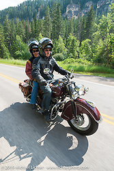 Kiwi Mike and Carolyn Tomas on the Legends Ride from Deadwood, SD through Spearfish Canyon and to the Sturgis Buffalo Chip during the Sturgis Black Hills Motorcycle Rally. SD, USA. August 4, 2014.  Photography ©2014 Michael Lichter.