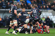Rhys Webb of the Ospreys © kicks the ball clear. Guinness Pro12 rugby match, Ospreys v Scarlets at the Liberty Stadium in Swansea, South Wales on Saturday 26th March 2016.<br /> pic by  Andrew Orchard, Andrew Orchard sports photography.