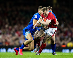 Hadleigh Parkes of Wales under pressure from Braam Steyn of Italy<br /> <br /> Photographer Simon King/Replay Images<br /> <br /> Six Nations Round 1 - Wales v Italy - Saturday 1st February 2020 - Principality Stadium - Cardiff<br /> <br /> World Copyright © Replay Images . All rights reserved. info@replayimages.co.uk - http://replayimages.co.uk