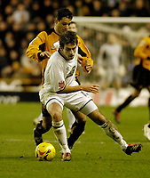 Photo: Leigh Quinnell.<br /> Wolverhampton Wanderers v Leeds United. Coca Cola Championship. 17/12/2005. Leeds' Simon Walton fights off Wolves'  Vio Ganea.