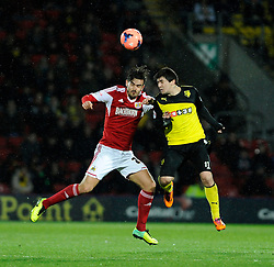 Watford's Fernando Forestieri challenges Bristol City's Marlon Pack to the ball in the air - Photo mandatory by-line: Dougie Allward/JMP - Tel: Mobile: 07966 386802 14/01/2014 - SPORT - FOOTBALL - Vicarage Road - Watford - Watford v Bristol City - FA Cup - Third Round - replay