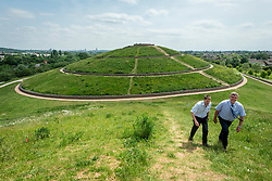 © Licensed to London News Pictures. 15/06/2021. LONDON, UK. Office workers out for lunchtime exercise and a walk up and down the mounds at Northala Fields in west London where the temperature is expected to rise to 25C with a forecast warmer 29C tomorrow.  Photo credit: Stephen Chung/LNP
