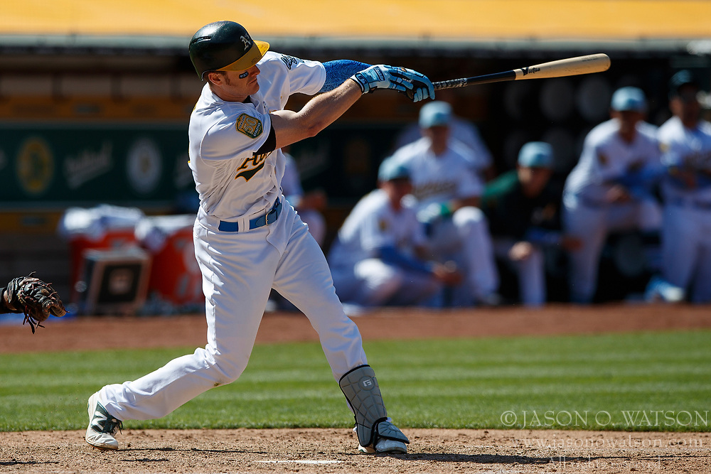OAKLAND, CA - JUNE 17: Mark Canha #20 of the Oakland Athletics at bat against the Los Angeles Angels of Anaheim during the ninth inning at the Oakland Coliseum on June 17, 2018 in Oakland, California. The Oakland Athletics defeated the Los Angeles Angels of Anaheim 6-5 in 11 innings. (Photo by Jason O. Watson/Getty Images) *** Local Caption *** Mark Canha