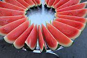 Fresh sliced watermelon for sale at an early morning street market in Yangon on 16th January 2016, Myanmar.  A large variety of local products are available for sale in fresh markets all over Yangon, all being sold on small individual stalls