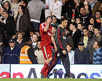 Jamie Carragher holds his head in his hand after being sent off<br /> F.A. Barclays Premiership. Fulham v Liverpool. 31.10.09<br /> Photo By Karl Winter Fotosports International