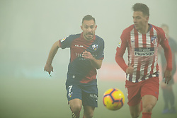January 19, 2019 - Huesca, Aragon, Spain - David Ferreiro of SD Huesca (7) competes for the ball with Arias of Atletico de Madrid (4) during the Spanish League football match between SD Huesca andClub Atletico de Madrid at the El Alcoraz stadium in Madrid on January 19, 2019. Atletico wins 0-3. (Credit Image: © Daniel Marzo/Pacific Press via ZUMA Wire)