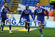 Cardiff City's Sean Morrison (r) runs to celebrate after scoring his teams 1st goal, chased by team mates Sol Bamba (c) and Anthony Pilkington (l).  EFL Skybet championship match, Cardiff city v Huddersfield Town at the Cardiff city stadium in Cardiff, South Wales on Saturday 19th November 2016.<br /> pic by Carl Robertson, Andrew Orchard sports photography.