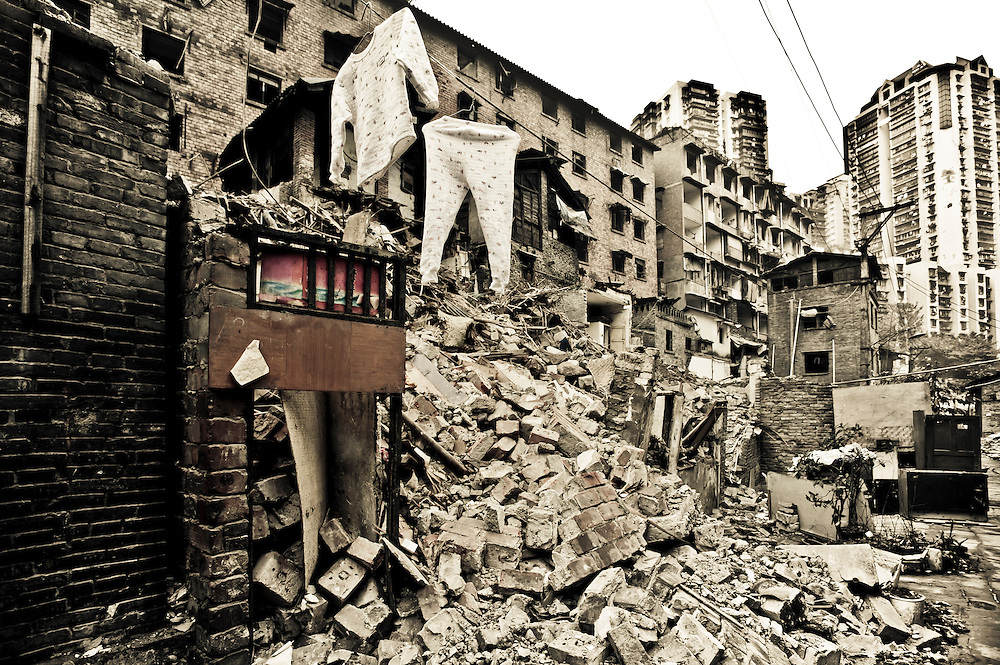 CHONGQING - JAN 11 2011: A child pijiamas is hanging in a partly  demolished area near Zhongshan Lu in Yuzhong district. A few families still leave here alongside razed houses and rubble.
