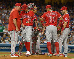 June 28, 2017 - Los Angeles, California, U.S. - Los Angeles Angels manager Mike Scioscia, left, pulls starting pitcher Jesse Chavez, center, from the game in the sixth inning of a Major League baseball game against the Los Angeles Dodgers at Dodger Stadium on Tuesday, June 27, 2017 in Los Angeles. (Photo by Keith Birmingham, Pasadena Star-News/SCNG) (Credit Image: © San Gabriel Valley Tribune via ZUMA Wire)