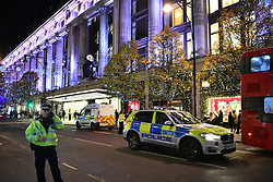 © Licensed to London News Pictures. 24/11/2017. London, UK. Armed police outside Selfridges at The scene at on Oxford Street after police responded to an incident. People have been advised to stay inside shops. Armed police are on the scene. Photo credit: Ben Cawthra/LNP